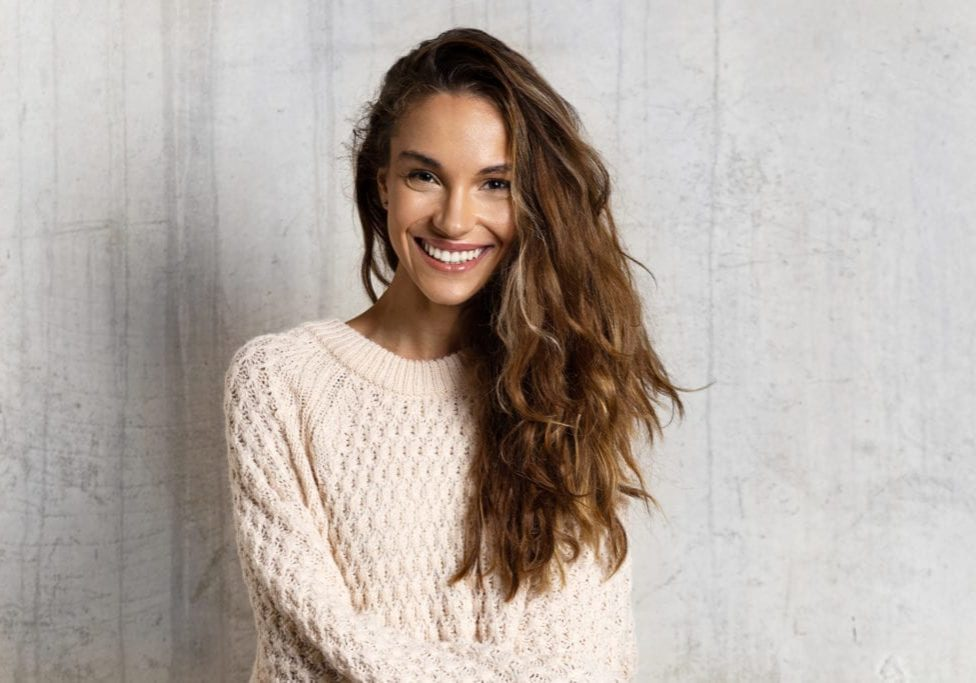 woman smilng in sweater portrait