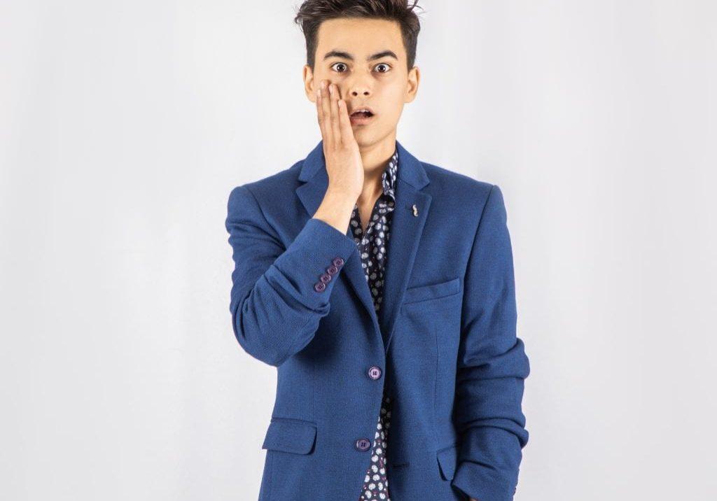images of shocked guy in blue blazer